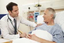 Doctor by Patient's Beside - 42402717_ml